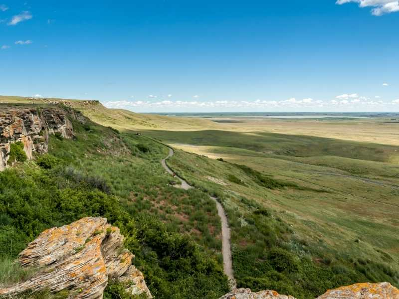 You can walk along a trail to get a good view of the buffalo jump.