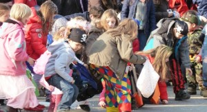 Children candy at Carnival parade in Stuttgart, Germany
