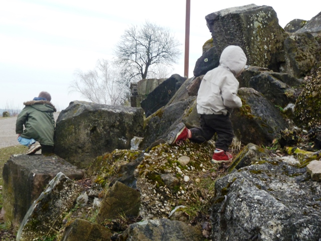 Children playing in rubble at the Birkenkopf Stuttgart, Germany