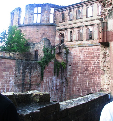 You can still see the damaged caused by one of the three fires to Heidelberg Castle.