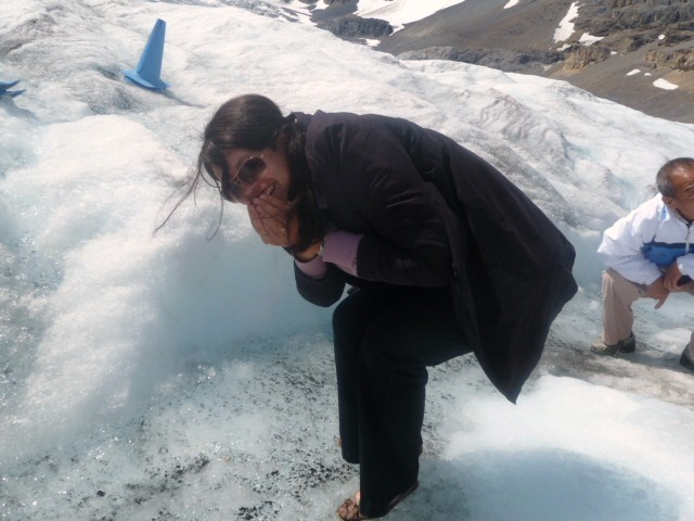 Drinking water at Athabasca Glacier on the Columbia Icefields