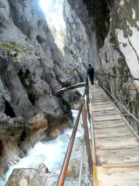Walking along the gorge on a wooden platform.