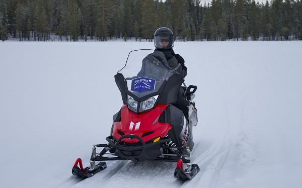 snowmobiling across a field