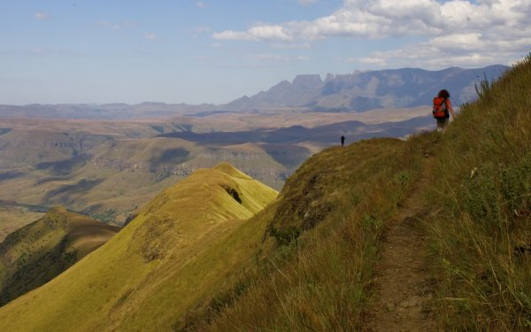Hiker on the trail to Orange Peel Gap in the Drakensberg Mountains South Africa