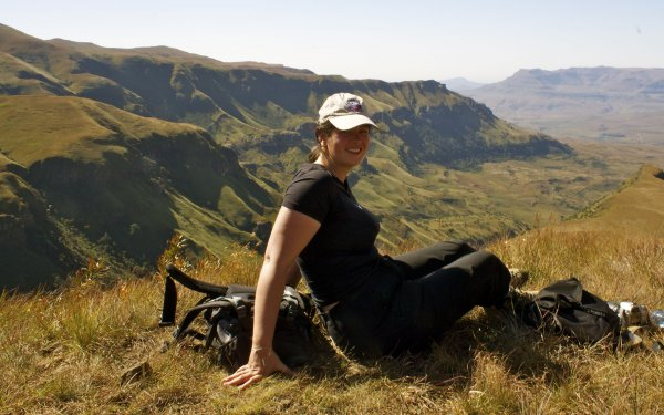 Adventure travel blogger, Laurel Robbins enjoying the views of the Drakensberg Mountains in South Africa