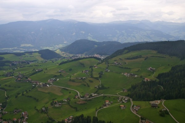 View while paragliding over Alpe di Siusi (Seiser Alm)