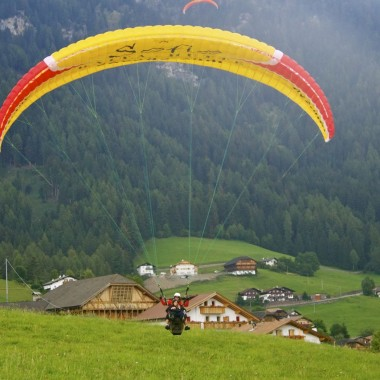 The paragliding landing in Alpe di Siusi (Seiser Alm), Italy