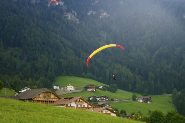 Preparing for the landing while paragliding in Alpe di Siusi (Seiser Alm)