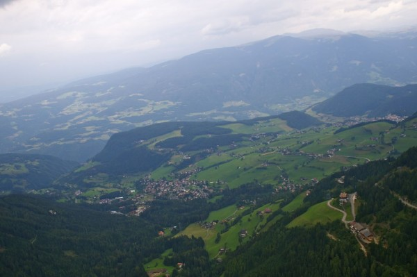 View while paragliding over Alpe di Suisi (Seiser Alm)
