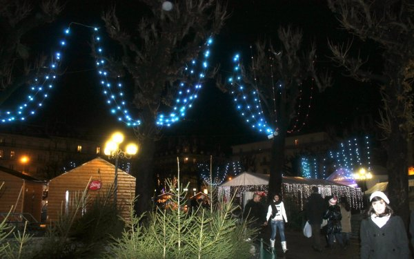 Lights hung from trees illuminate the Christmas Market.