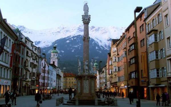 The Old Town in Innsbruck, Austria is surrounded by mountains, making for a romantic setting.