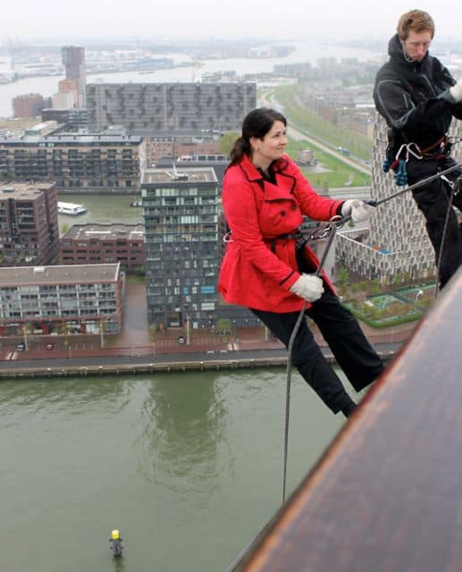 Hesitating before taking the final step into thin air to start the abseil.