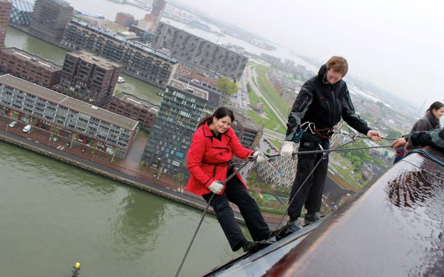 Getting ready to step off the ledge while abseiling from the Euromast.