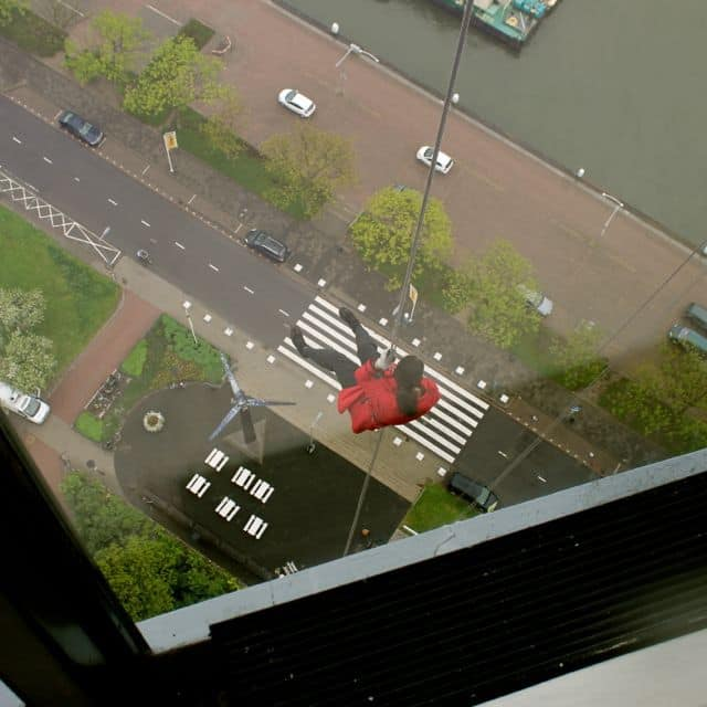More than halfway down while abseiling from the Euromast.