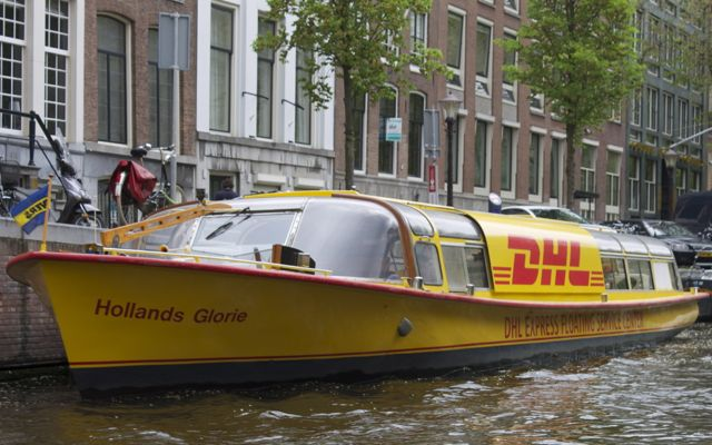 Courier boat on a canal in Amsterdam.