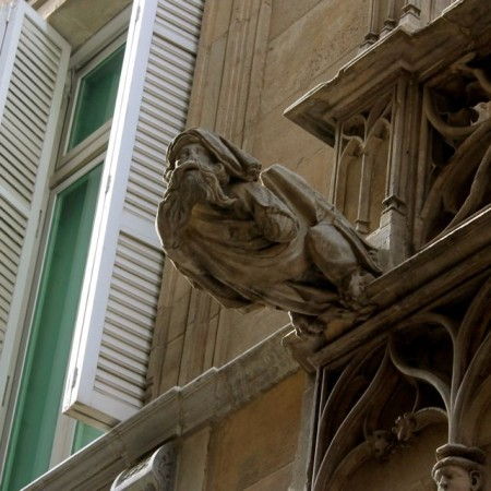 Petrified wizard on Bisbe Street in Barcelona's Gothic Quarter.