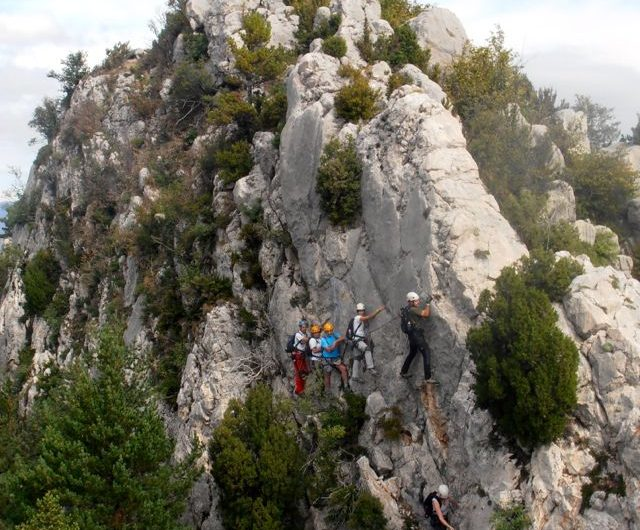 Adventure travel blog. Hanging to a cliff.