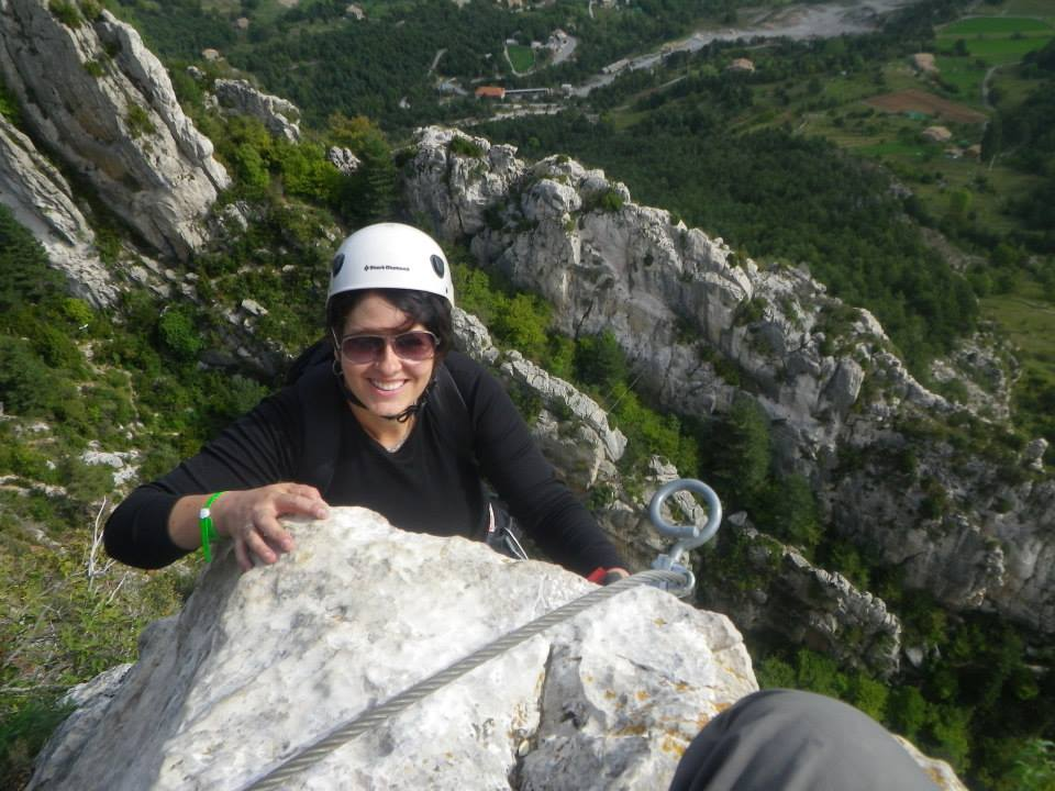 Laurel Robbins climbing up a mountain