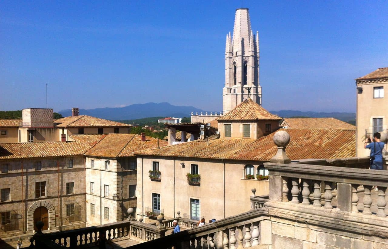 Overlooking the Collegiate Church of Sant Feliu and the Pyrenees
