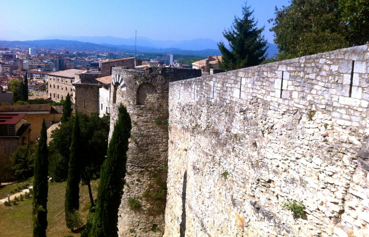 Overlooking the wall with a view stretching all the way to the Pyrenees mountains.