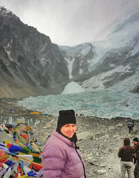 Laurel arriving at Everest Base Camp after 8 days of trekking.