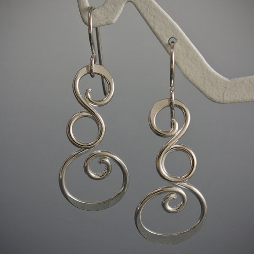Silver earrings go with everything and are the perfect gift for travelers!