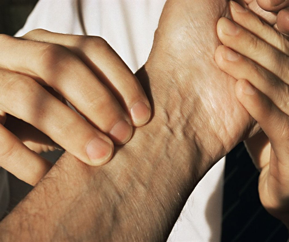 Feeling the pulse is one way Ayuredic doctors can diagnose ailments.