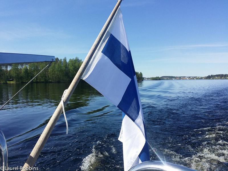 Finnish flag while cruising Lake Saimaa, looking for Saimaa ringed seals in Savonlinna, Finland.