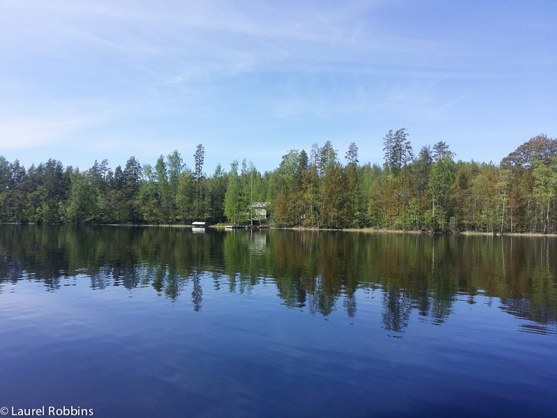 Cottages, dot the shoreline of Lake Saimaa in Savonlinna, Finland