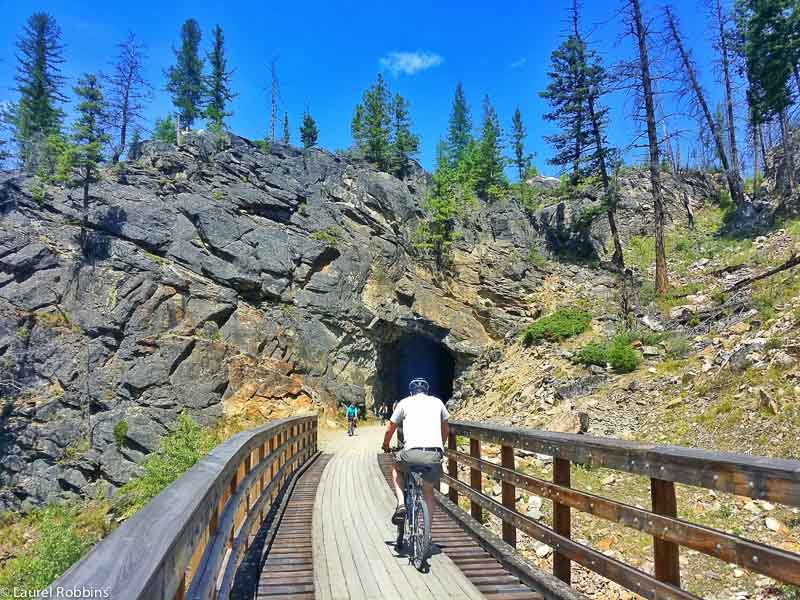 As part of the Myra Canyon scenic cycle route in Kelowna, cyclists go through 2 former railway tunnels.
