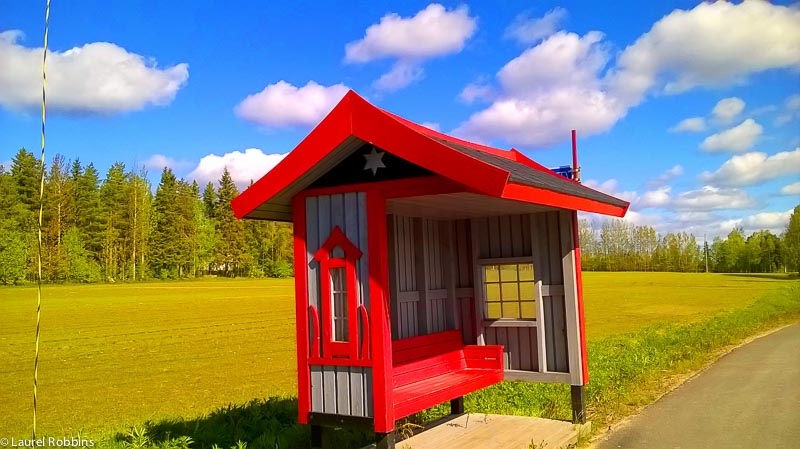 colourful bus stops in rural Finland