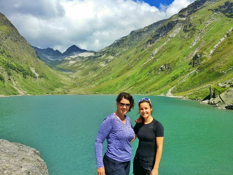 Moa Alm adventures in Austrian Alps, an alpine lake surrounded by mountains