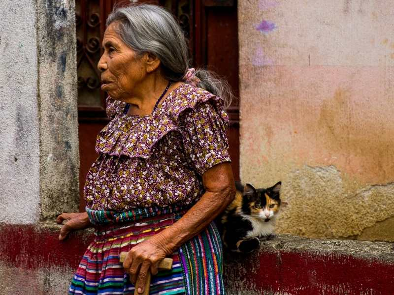 an elderly Guatemalan lady and a cat