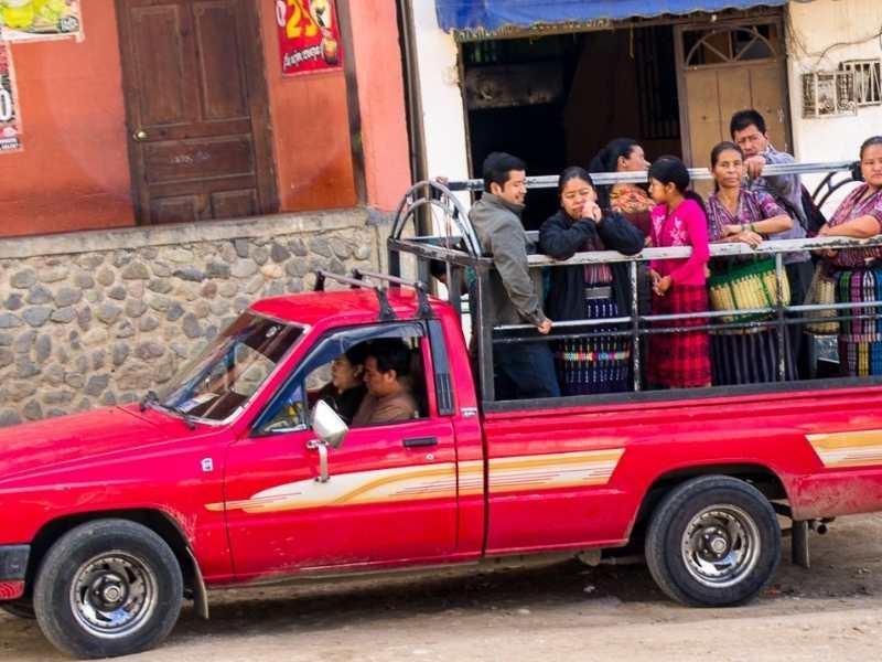 Guatemalan people taking a collective taxi in a village near Lake Atitlan