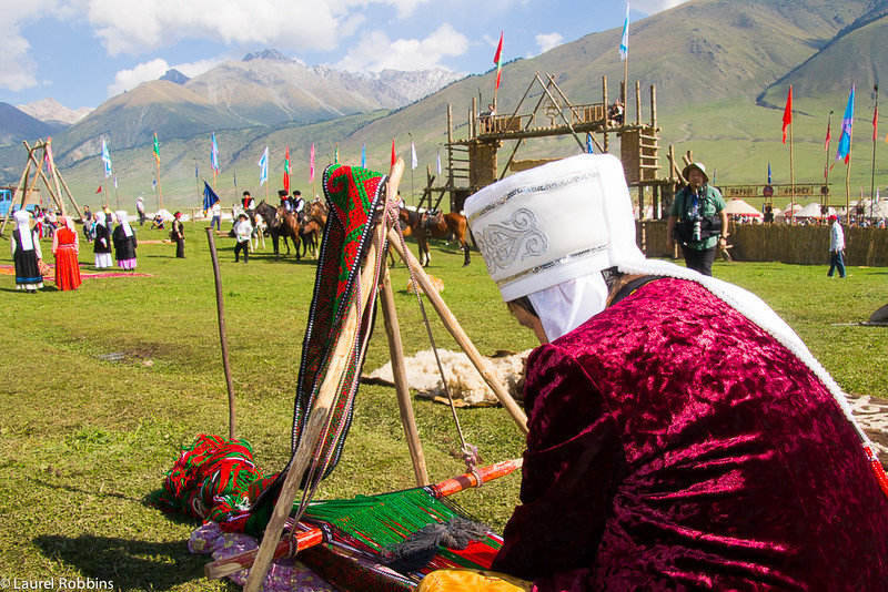 In the gorgeous setting of Kyrchyn Jailoo a Kyrgyz woman weaves.