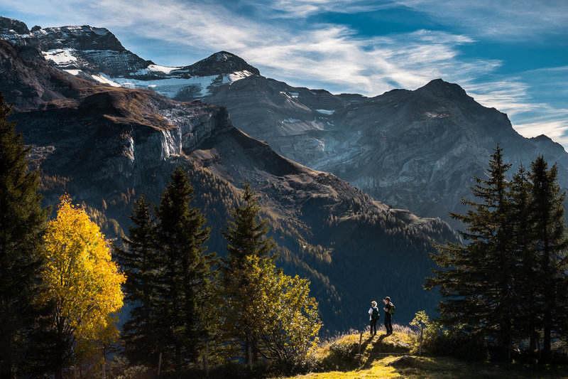 Couple enjoying incredible mountain views while hiking