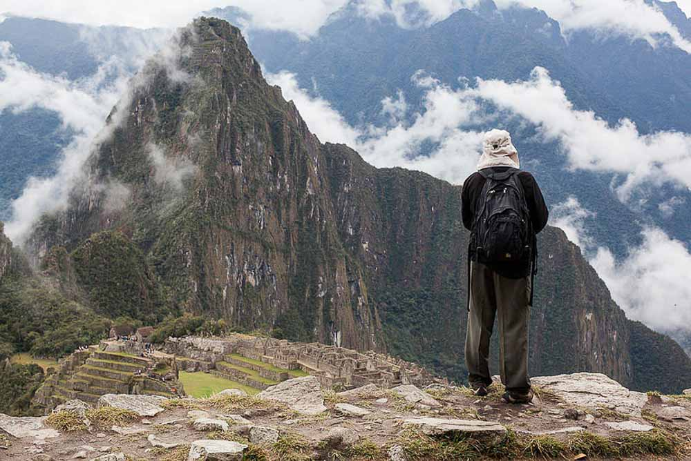 Hiker looking at Machu Picchu