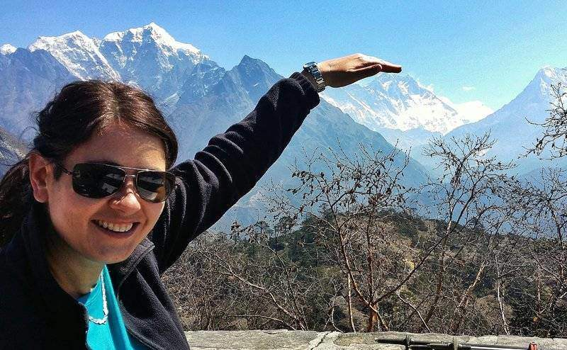 Adventure travel blogger, Laurel Robins having fun with Mount Everest