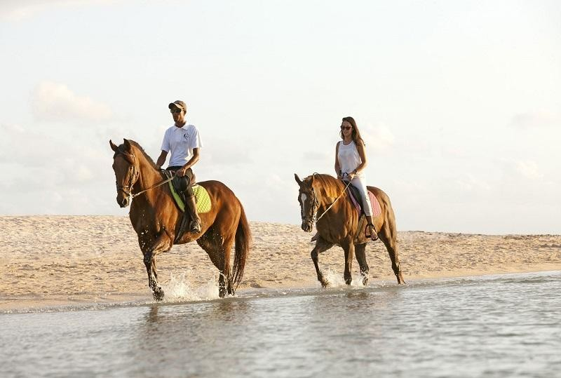 Horseback riding along the miles and miles of beaches in Mauritius