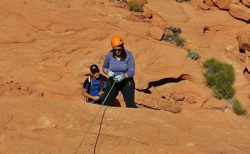 adventure travel blogger Laurel Robbins rappelling in Valley of Fire State Park in Nevada.