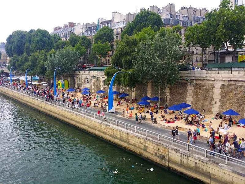 sun bathe along the River Seine while in Paris