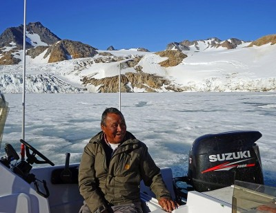 Greenlandic Inuit on his boat.