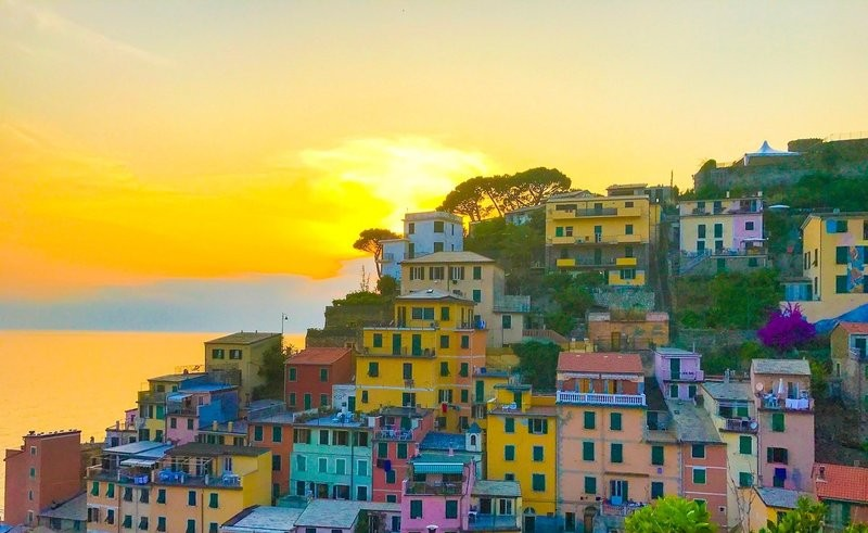 time your visit for a sunset over Riomagiorre on your Cinque Terre walking tour