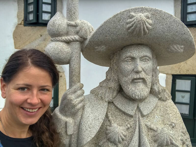 Pilgrim and statue of St James, who the Camino is named after 'The Way of St. James.'
