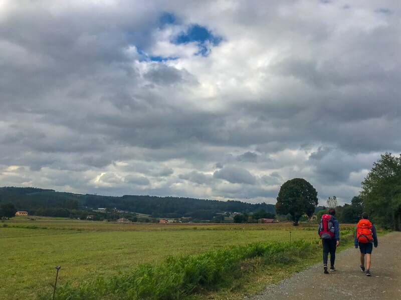 Two pilgrims walking a flat part of the Camino de Santiago (the last 100 km).