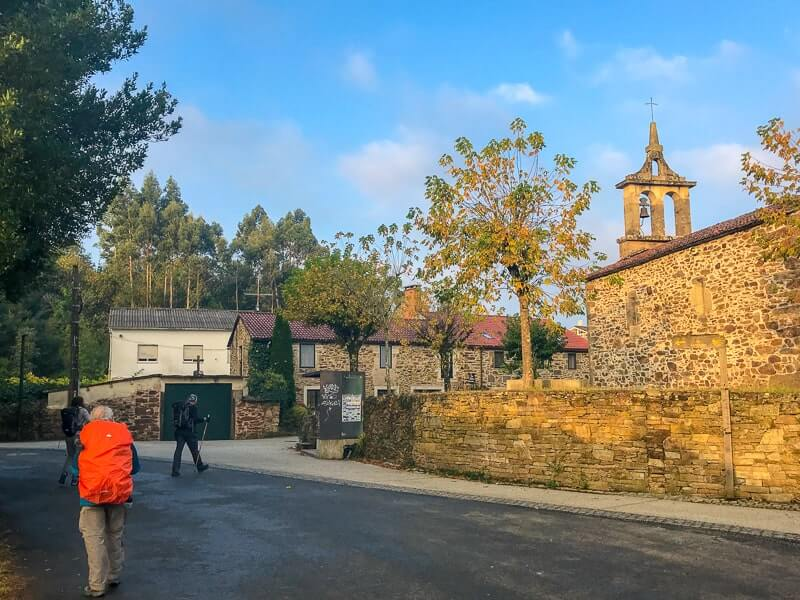 Pilgrim and a church on the Camino de Santiago