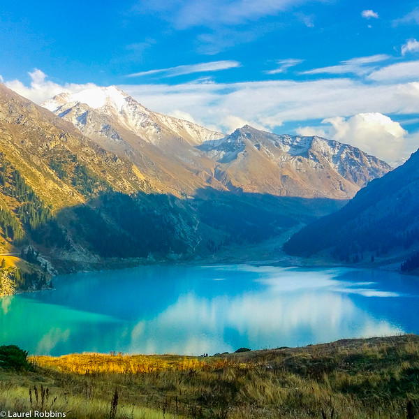 You'll find 3 peaks at ~ 4000 m high in the Tian Shan Mountains surrounding Big Almaty Lake