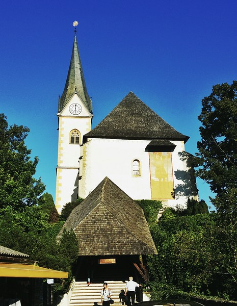 Pilrims and tourists visit the Pilgrim church in the village of Maria Wörth, on a peninsula on the Wörthersee.