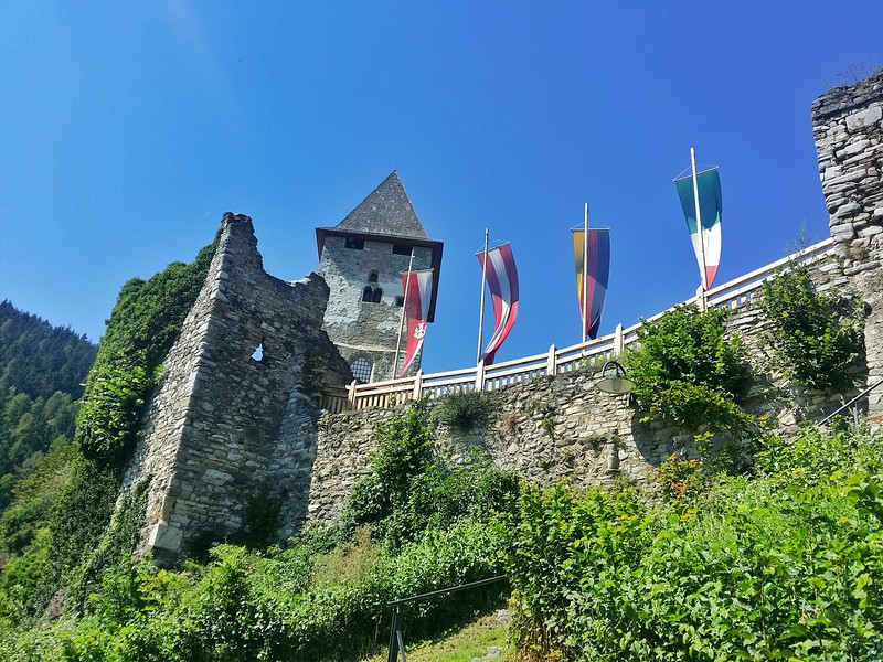 The ruins of Petersberg wall and castle sit on a mountain overlooking the medieval town of Friesach.