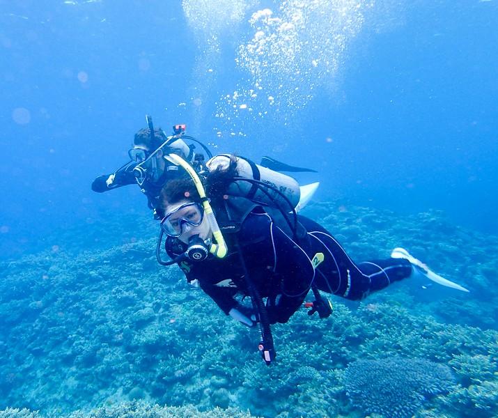 Adventure travel blogger Laurel Robbins diving Keramashoto National Park in Okinawa.
